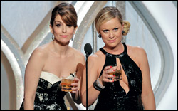 Hosts Tina Fey, Amy Poehler on stage during the 70th Annual Golden Globe Awards