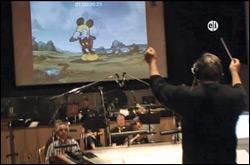Marcos Watters dirige un orch re-grabación de música para Disney toons.